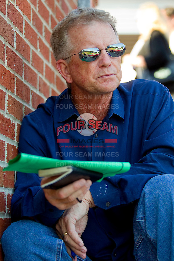 Chicago Cubs scouting director Tim Wilken takes in the Atlantic Coast Conference game between the Duke Blue Devils and the North Carolina State Wolfpack at Doak Field at Dail Park on April 27, 2012 in Raleigh, North Carolina.  (Brian Westerholt/Four Seam Images)