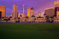 Sultan Abdul Amad building, Petronas Twin Towers, and the KL Tower from Dataran Merdeka.  Kuala Lumpur, Malaysia.