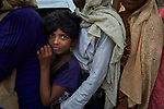 A Rohingya refugee girl waits in a line for food in the sprawling Kutupalong Refugee Camp near Cox's Bazar, Bangladesh. More than 600,000 Rohingya have fled government-sanctioned violence in Myanmar for safety in Bangladesh.