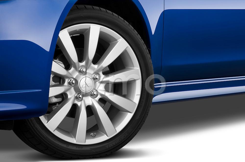 Tire and wheel closeup view of a 2010 Mitsubishi Lancer Sportback GTS