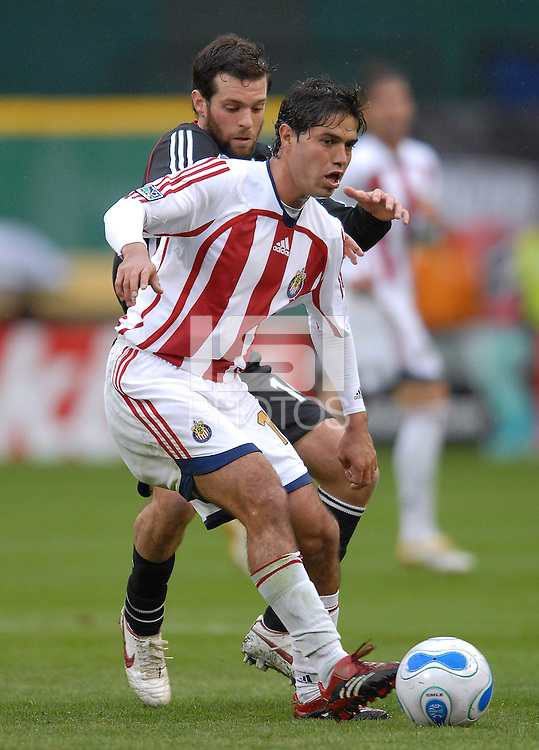 2006 MLS Regular Season Match at RFK Stadium,Chivas USA Defender Jonathan Bornstein defending the play against midfielder Ben Olsen, final score DC United 2  , Chivas USA  0 , Saturday, April 8.