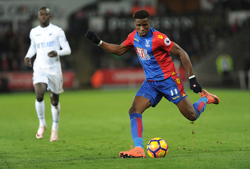 Crystal Palace's Wilfried Zaha in action during todays match  <br /> <br /> Photographer Ashley Crowden/CameraSport<br /> <br /> The Premier League - Swansea City v Crystal Palace - Saturday 26th November 2016 - Liberty Stadium - Swansea <br /> <br /> World Copyright &copy; 2016 CameraSport. All rights reserved. 43 Linden Ave. Countesthorpe. Leicester. England. LE8 5PG - Tel: +44 (0) 116 277 4147 - admin@camerasport.com - www.camerasport.com