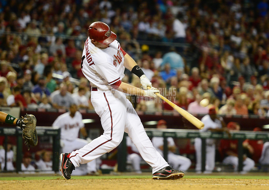 Jun. 8, 2012; Phoenix, AZ, USA; Arizona Diamondbacks first baseman Paul Goldschmidt hits a solo home run in the fifth inning against the Oakland Athletics at Chase Field.  Mandatory Credit: Mark J. Rebilas-=