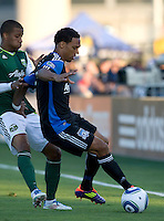 Scott Sealy of Earthquakes controls the ball away from Jeremy Hall of Timbers during the game at Buck Shaw Stadium in Santa Clara, California on August 6th, 2011.   San Jose Earthquakes and Portland Timbers tied 1-1.