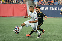 FOXBOROUGH, MA - AUGUST 4: Brandon Bye #15 of New England Revolution retrieves the ball from Diego Rossi #9 of Los Angeles FC near the New England goal during a game between Los Angeles FC and New England Revolution at Gillette Stadium on August 3, 2019 in Foxborough, Massachusetts.