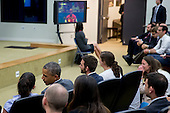 United States President Barack Obama, bottom left, talks to a staff member as he watches the USA v. Belgium World Cup game at the Eisenhower Executive Office Building next to the White House in Washington, D.C., U.S., on Tuesday, July 1, 2014. The U.S. is tied 0-0 with Belgium in a match to decide who meets Argentina in the quarterfinals of soccer's World Cup in Brazil. <br /> Credit: Andrew Harrer / Pool via CNP