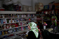 BULGARIA, Kornitsa, April 8, 2011. A Bulgarian muslim woman is seen in a shop in the remote village of Kornitsa in the Rhodope Mountains, southern Bulgaria. Bulgarian Muslims, which today are nearly 8% of the country's population and the largest muslim minority community in the European Union, revived their cultural and religious traditions after the fall of communist regime in Bulgaria in 1989. .BULGARIE, Kornitsa, 8 Avril 2011. Une Bulgare de confession musulmane dans un magasin du petit village de Kornitsa dans les montagnes des Rhodopes en Bulgarie. La minorité musulmane qui représente aujourd'hui près de 8% de la population totale du pays et qui est la plus large majorité musulmane dans les pays de l'Union Européenne a ravive ses traditions culturelles et religieuse après la chute du régime communiste Bulgare en 1989.