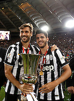Calcio, finale Tim Cup: Juventus vs Lazio. Roma, stadio Olimpico, 20 maggio 2015.<br /> Juventus' Fernando Llorente, left, and Alvaro Morata hold the trophy at the end of the Italian Cup final football match between Juventus and Lazio at Rome's Olympic stadium, 20 May 2015. Juventus won 2-1 after extra time.<br /> UPDATE IMAGES PRESS/Isabella Bonotto