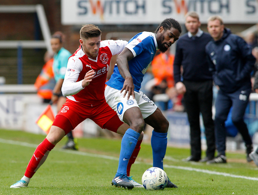 Fleetwood Town's Wes Burns battles with Peterborough United's Anthony Grant<br /> <br /> Photographer David Shipman/CameraSport<br /> <br /> The EFL Sky Bet League One - Peterborough United v Fleetwood Town - Friday 14th April 2016 - ABAX Stadium  - Peterborough<br /> <br /> World Copyright &copy; 2017 CameraSport. All rights reserved. 43 Linden Ave. Countesthorpe. Leicester. England. LE8 5PG - Tel: +44 (0) 116 277 4147 - admin@camerasport.com - www.camerasport.com