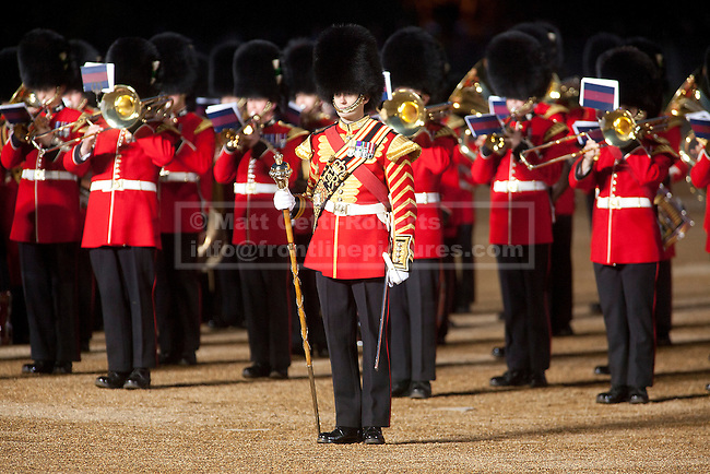 13/06/2012. LONDON, UK. Members of the Household Division perform during the annual Beating Retreat parade at Horse Guards Parade in London. On two successive evenings each year in June a pageant of military music, precision drill and colour takes place on Horse Guards Parade in the heart of London when the Massed Bands of the Household Division carry out the Ceremony of Beating Retreat. 300 musicians, drummers and pipers perform this age-old ceremony. The Retreat has origins in the early days of chivalry when beating or sounding retreat pulled a halt to the days fighting. Photo credit: Matt Cetti-Roberts