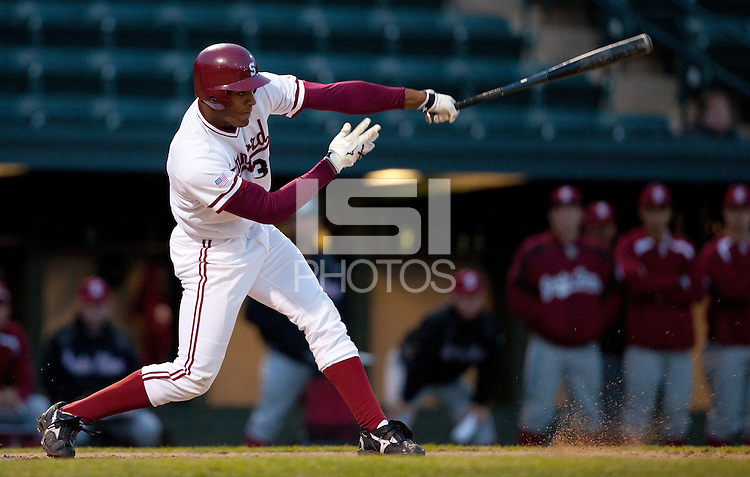 STANFORD, CA - March 1, 2011: Austin Wilson of Stanford baseball hits an infield single during Stanford's game against Santa Clara at Sunken Diamond. Stanford won 8-4.