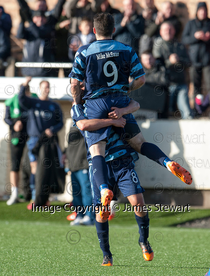 Forfar's Dale Hilson (9) is congratulated by James Dale (8) after he scores their first goal.
