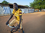 A man on a bike in Bunj, a town in Maban County, South Sudan. Maban is host to four refugee camps that together shelter more than 130,000 refugees from the Blue Nile region of Sudan. Jesuit Refugee Service, with support from Misean Cara, provides educational and psycho-social services to both refugees in the camps and the host community.