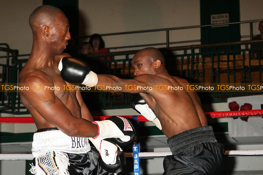 Francis Maina (black shorts) draws with Barrington Brown in a Lightweight boxing contest at York Hall, Bethnal Green, promoted by Miranda Carter/Left Jab Promotions - 18/09/11 - MANDATORY CREDIT: Gavin Ellis/TGSPHOTO - Self billing applies where appropriate - 0845 094 6026 - contact@tgsphoto.co.uk - NO UNPAID USE.