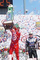 Jun. 22, 2008; Newton, IA, USA; IRL driver Dan Wheldon celebrates after winning the Iowa Corn Indy 250 alongside third place finisher Marco Andretti (right) at the Iowa Speedway. Mandatory Credit: Mark J. Rebilas-