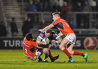 Sale Sharks Josh Charnley tackled by Saracens No 12 Brad Barritt and No 10 Owen Farrell during the European Rugby Champions Cup match between Sale Sharks and Saracens at AJ Bell Stadium, Salford, England on 18 December 2016. Photo by Paul Bell.