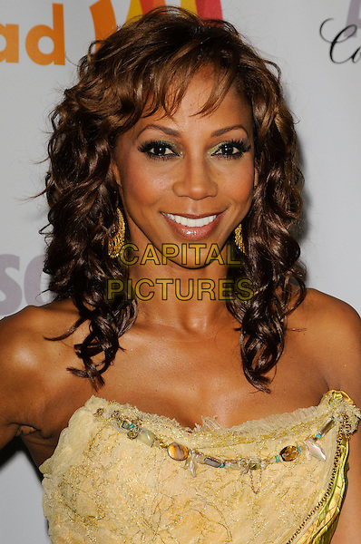 HOLLY ROBINSON PEETE .arriving at the 21st Annual GLAAD Media Awards at the Hyatt Century Plaza Hotel in Century City, California, USA, April 17th, 2010..arrivals portrait headshot smiling  eyeshadow make-up gold earrings strapless yellow green   .CAP/ROT.©Lee Roth/Capital Pictures