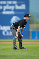 Umpire Skyler Shown handles the calls on the bases during the Carolina League game between the Winston-Salem Dash and the Salem Red Sox at LewisGale Field at Salem Memorial Ballpark on May 14, 2015 in Salem, Virginia.  The Red Sox defeated the Dash 1-0.  (Brian Westerholt/Four Seam Images)