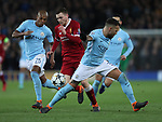 Andrew Robertson of Liverpool goes between Fernandinho of Manchester City and Nicolas Otamendi of Manchester City during the Champions League Quarter Final 1st Leg, match at Anfield Stadium, Liverpool. Picture date: 4th April 2018. Picture credit should read: Simon Bellis/Sportimage