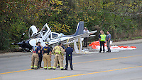 NWA Democrat-Gazette/MICHAEL WOODS • @NWAMICHAELW<br /> Emergency responders work to secure the scene of a small airplane crash on Martin Luther King Blvd in Fayetteville Tuesday November 3, 2015.  Three people were on the aircraft that deployed an emergency parachute attached to the airplane while trying to make an emergency landing at Drake field in Fayetteville after experiencing an oil pressure loss after taking off from the Bentonville airport.