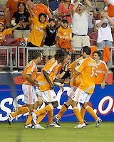 Houston Dynamo midfielder Brian Mullan (9), forward Joseph Ngwenya (33), forward Nate Jaqua (21), and defender Ryan Cochrane (5) celebrate a Dynamo goal. The Houston Dynamo defeated Real Salt Lake 4-3 during an MLS regular season game at Robertson Stadium in Houston, TX on September 8, 2007.