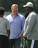 Mike Maccagnan, New York Jets General Manager, center, chats with Head Coach Todd Bowles during the first day of team training camp at Atlantic Health Jets Training Center in Florham Park, NJ on Thursday, July 28, 2016.