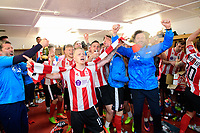 Lincoln City's Terry Hawkridge, left, and Lincoln City's assistant manager Nicky Cowley, right, celebrate in the changing room after the game<br /> <br /> Photographer Chris Vaughan/CameraSport<br /> <br /> Vanarama National League - Lincoln City v Macclesfield Town - Saturday 22nd April 2017 - Sincil Bank - Lincoln<br /> <br /> World Copyright &copy; 2017 CameraSport. All rights reserved. 43 Linden Ave. Countesthorpe. Leicester. England. LE8 5PG - Tel: +44 (0) 116 277 4147 - admin@camerasport.com - www.camerasport.com