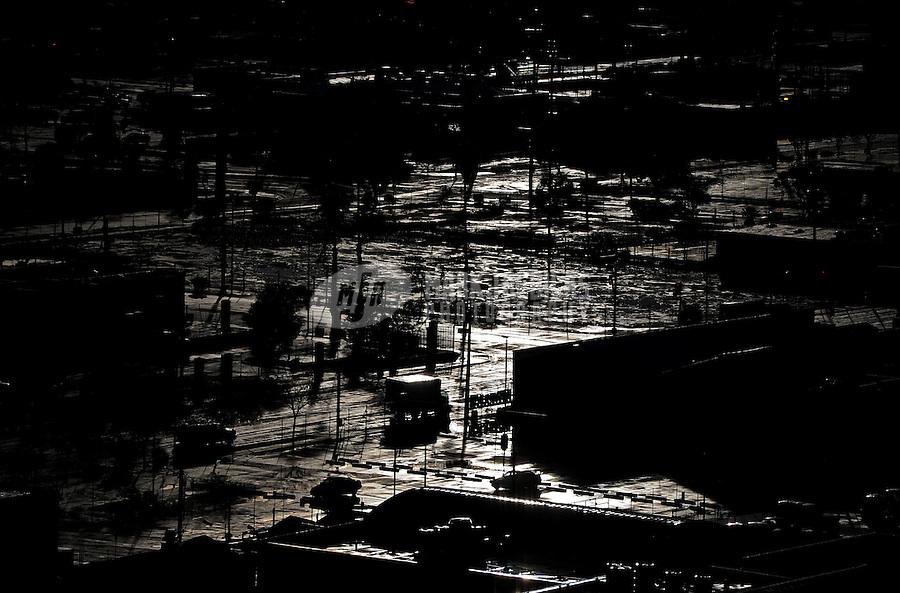rain sun water Phoenix Arizona weather storm chaser chasing city urban road silhouette