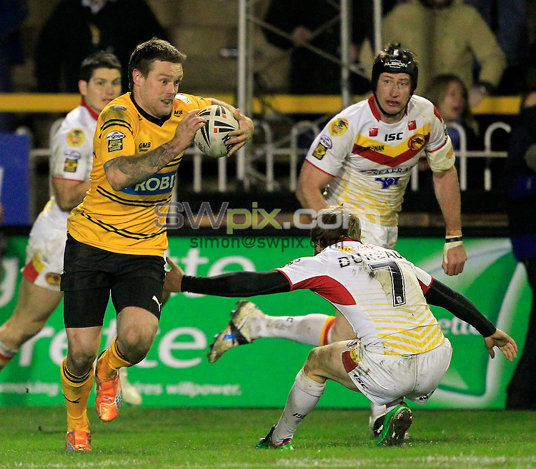 PICTURE BY CHRIS MANGNALL /SWPIX.COM...Rugby League - Super League - Castleford Tigers v Catalan Dragons  - Probiz Coliseum, Castleford, England - 12/03/11...Castleford's Nick Youngquest avoids a tackle by Catalan's Scott Dureau to run the length of field to score a try.
