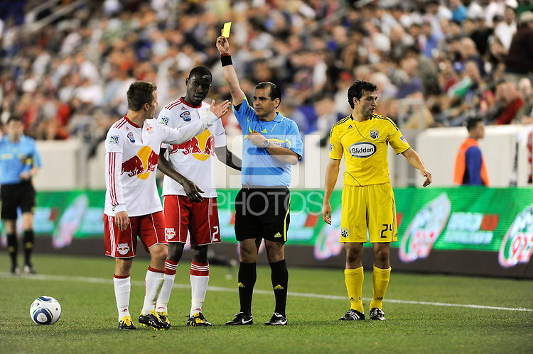 Referee Baldomero Toledo issues a yellow card to Seth Stammler (6) of the New York Red Bulls. The Columbus Crew defeated the New York Red Bulls 3-1 during a Major League Soccer (MLS) match at Red Bull Arena in Harrison, NJ, on May 20, 2010.