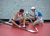 Shunyi, CHINA. GBR M4- Peter REED sits with his gold medal and chats with the boat holder, who takes a picture of the Gold medal, after the medal ceremony,  Olympic Regatta, Shunyi Rowing Course.  Sunday  17/08/2008  [Mandatory Credit:  Svend Aage Nielsen/  Intersport Images]