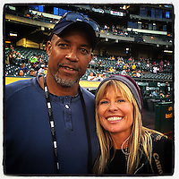 OAKLAND, CA - SEPTEMBER 17: Instagram of photographers Thearon Henderson and Jean Fruth on the field before the game between the Texas Rangers and Oakland Athletics at O.co Coliseum on September 17, 2014 in Oakland, California. Photo by Brad Mangin