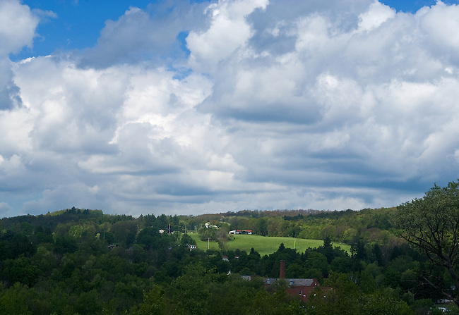 An example of the beautiful cloud-filled blue skies above expansive farmlands one often sees as they travel Rte. 88 in New York State.