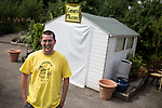 © Joel Goodman - 07973 332324 . 27 July 2013 . Hulme Community Garden Centre , Old Birley Street , Hulme , Manchester M15 , UK . Martin Livesey of Venture Arts Photography Group outside a camera obscura built in to a shed . He is part of the Venture Arts Photography Group (contact 07855 530197) and facilitated the construction . Hulme is Where the Art Is festival . Photo credit : Joel Goodman