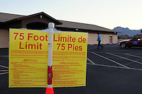 "Apache Junction, Arizona. November 6, 2012 - A bilingual ""75 Foot Limit"" sign on a the parking lot next of Precinct 44 at a Moose Lodge chapter building in Apache Junction, Arizona warns people that only registered voters casting their vote are allowed within this limit. Photo by Eduardo Barraza © 2012"