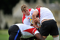 Tom Woolstencroft of Bath Rugby is double-tackled. Bath Rugby training session on September 4, 2015 at Farleigh House in Bath, England. Photo by: Patrick Khachfe / Onside Images