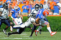 21 November 2009:  FIU cornerback Jonathan Cyprien (25) tackles Florida wide receiver Riley Cooper (11) in the first half as the University of Florida Gators defeated the FIU Golden Panthers, 62-3, at Ben Hill Griffin Stadium in Gainesville, Florida.