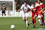 15 November 2009: Virginia's Jordan Evans (2) and NC State's Farouk Bseiso (5) chase the ball. The University of Virginia Cavaliers defeated the North Carolina State University Wolfpack at WakeMed Stadium in Cary, North Carolina in the Atlantic Coast Conference Men's Soccer Tournament Championship game.