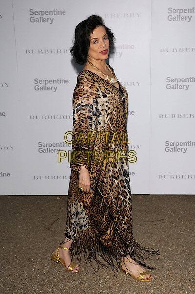 Bianca Jagger.Serpentine Gallery Summer Party, Kensington Palace Gardens, London 29th June 2011.full length leopard animal print.CAP/PL.©Phil Loftus/Capital Pictures.