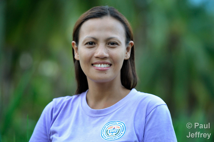 Eva Gantuangco is a survivor of human trafficking in Japan, where she worked as an entertainer. Here, outside Digos on the southern island of Mindanao in the Philippines, she poses on a four hectare farm she bought with her earnings. Gantuangco, who testified against her traffickers, has been assisted by the Batis Center for Women.