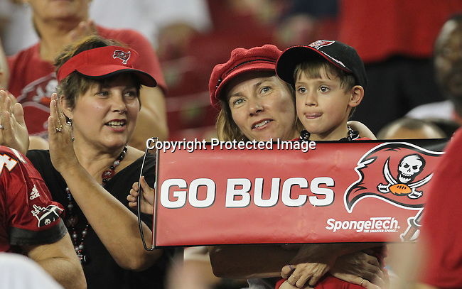 Tampa Bay Buccaneer's fans enjoy the win against the Kansas City Chiefs. The Buccaneers defeated the Chiefs  20-15 during an NFL preseason game Saturday, Aug. 21, 2010 in Tampa,Fla. (AP Photo/Margaret Bowles).
