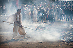 A Buddhist monk rakes ash from the ceremonial fire during the Fire-walking Festival (Hiwatari-sai) at Mt. Takao on Sunday, March 12, 2017 in Hachioji, Japan.<br /> Photo by Kevin Clifford