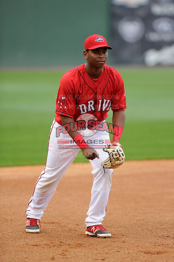 Third baseman Rafael Devers (13) of the Greenville Drive during a Media Day first workout of the season on Tuesday, April 7, 2015, at Fluor Field at the West End in Greenville, South Carolina. (Tom Priddy/Four Seam Images)