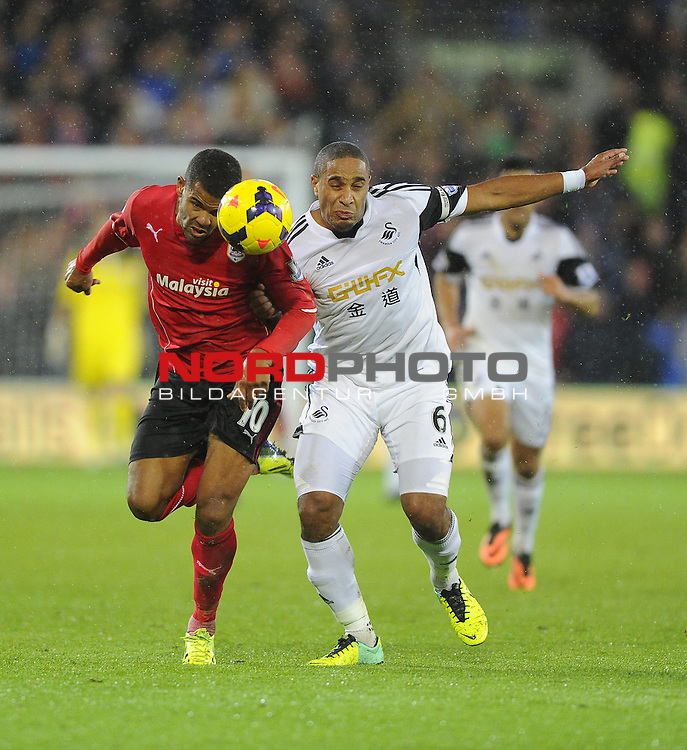 Cardiff City's Fraizer Campbell battles for the ball with Swansea City's Ashley Williams -   03/11/2013 - SPORT - FOOTBALL - The Cardiff City Stadium - Cardiff - Cardiff City v Swansea City - Barclays Premier League<br /> Foto nph / Meredith<br /> <br /> ***** OUT OF UK *****
