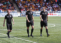 Matches officials Referee Don Robertson (centre) with Assistant Referee David McGeachie (right) and Assistant Referee Alan Macfadyen in the SPFL Betfred League Cup group match between Queen of the South and Motherwell at Palmerston Park, Dumfries on 13.7.19.