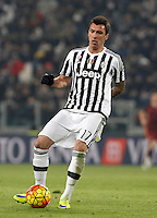 Juventus' Mario Mandzukic in action during the Italian Serie A football match between Juventus and Roma at Juventus Stadium.
