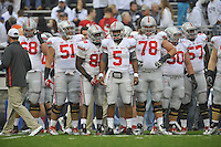 27 October 2012:  Ohio State's Joel Hale (51), Stacey Blount (88), Braxton Miller (5), and Andrew Norwell (78).  The Ohio State Buckeyes defeated the Penn State Nittany Lions 35-23 at Beaver Stadium in State College, PA.