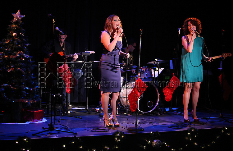 Andrea Burns & Janet Dacal.performing in the 6th Annual Broadway Sings for Toys For Tots at Symphony Space in New York City. 12/19/2011