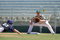 Slippery Rock infielder Kyle Vozar (26) waits for a throw as Connor Petschke (23) dives back to first during a game against Kentucky Wesleyan College at Jack Russell Stadium on March 14, 2014 in Clearwater, Florida.  Slippery Rock defeated Kentucky Wesleyan 18-13.  (Mike Janes/Four Seam Images)