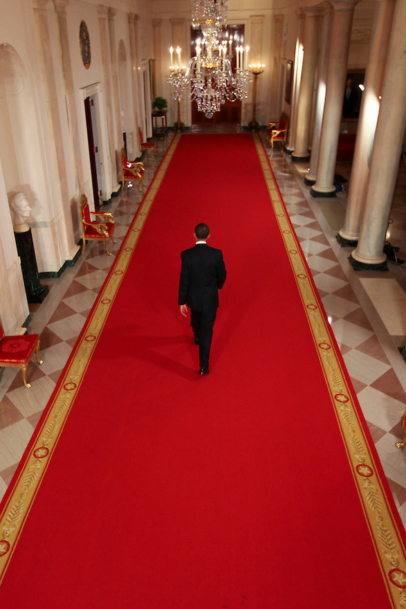 President Barack Obama walks down the Cross Hall at the end of a news conference in the East Room of the White House in Washington, DC...Photo by Brooks Kraft/Corbis......................